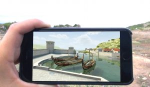 An image of a person holding a phone to see a canal and boats on the screen.