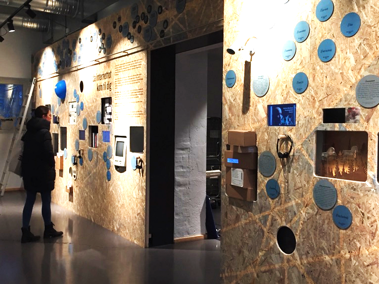 A view of the exhibition, made out of screens, plywood, and interactives
