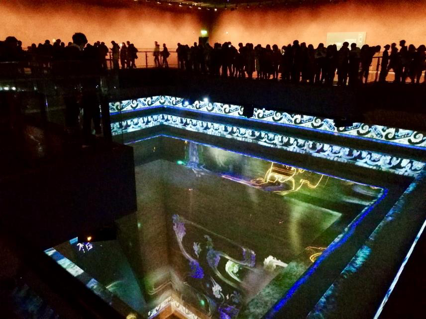 "A photo showing what the ""Dream of Eternity"" exhibition looks like with viewers inside it."
