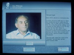 A display monitor showing an oral history interview.