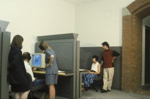 Visitors using computer terminals in a museum.