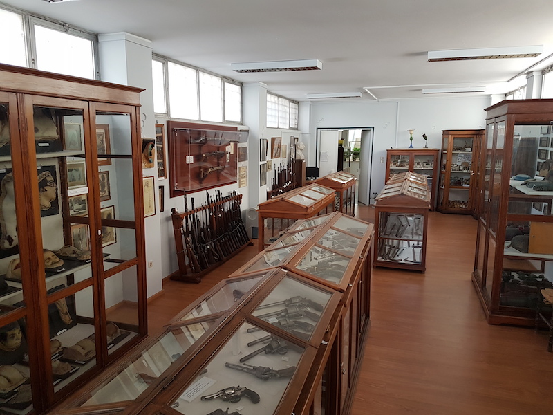 A view of a museum gallery with wooden cases