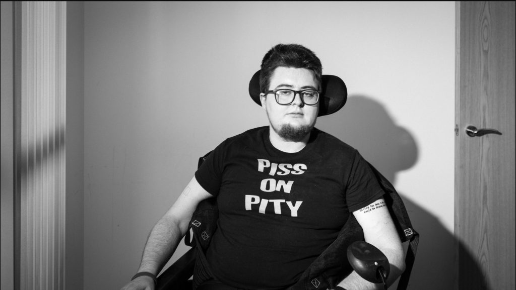 A black-and-white photo of a man in a wheelchair.